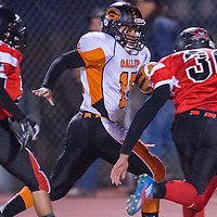 110113       Cable Hoover<br /> <br /> Gallup Bengal Brandon Mayes (15) dodges the Grants Pirate defense on his way to a touchdown Friday at Grants High School.