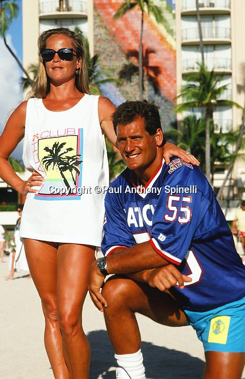 The National Football Conference Minnesota Vikings linebacker Scott Studwell (55) poses for a photo with his wife on Waikiki Beach after photo day the week before the 1989 NFL Pro Bowl football game against the American Football Conference on Jan. 24, 1989 in Honolulu. The NFC won the game 34-3. (©Paul Anthony Spinelli)