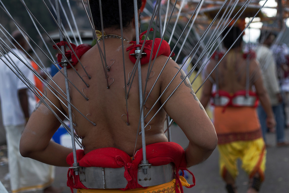 HIndu devotee walk with his 'kavadi' (burden) to the Batu Cave temple during a Thaipusam festival in Kuala Lumpur, Malaysia, 03 Fenruary 2015.  Thousands of Hindus gather to participate in the annual Thaipusam festival dedicated to Lord Murugan. During Thaipusam day, devotees will fulfilled their vows by carrying 'kavadi (bearers had spikes pierced into their bodies) or pots of milk as offering to Lord Murugan. The devotees will make the arduous climbing up the 272 steps leading up to the temple cave and deposited at the feet of the deity to purify themselves.