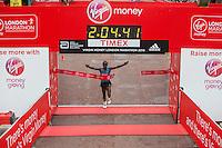 Eliud Kipchoge of Kenya crosses the line to win the Elite Mens race at the Virgin Money London Marathon , Sunday 26th April 2015.<br /> <br /> Dillon Bryden for Virgin Money London Marathon<br /> <br /> For more information please contact Penny Dain at pennyd@london-marathon.co.uk