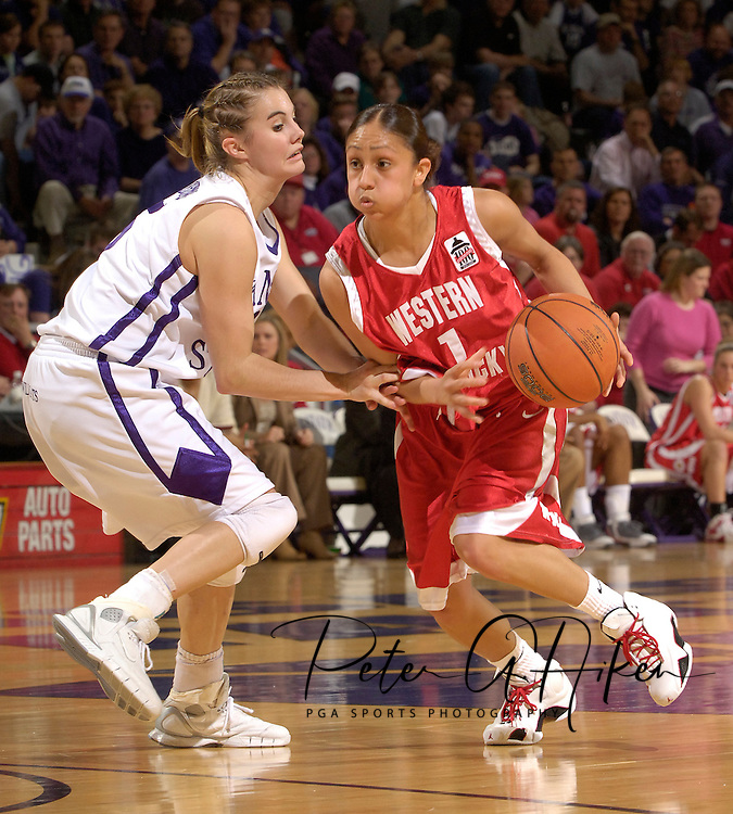 Western Kentucky guard Tifany Zaragoza (R) drives against pressure from Kansas State's Shelee Lehning (L), during the first half at Bramlage Coliseum in Manhattan, Kansas, March 28, 2006.  K-State defeated Western Kentucky 57-56 in overtime of the WNIT Semifinals.