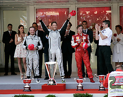 MONTE-CARLO, MONACO - Sunday, May 24, 2009: Jenson Button (GBR Brawn GP) celebrates winning the Monte-Carlo Grand prix as team-mate Rubens Barrichello (BRA Brawn GP) finishes second and Kimi Raikkonen (FIN Ferrari) third during the Monaco Formula One Grand Prix at the Monte-Carlo Circuit. (Pic by Juergen Tap/Hoch Zwei/Propaganda)