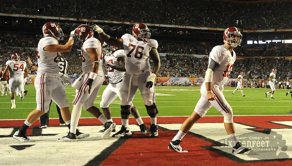 Daily Photo by Gary Cosby Jr.   Alabama quarterback AJ McCarron (10) celebrates with teammates after a Bama touchdown during the first half of the BCS National Championship Game in Sun Life Stadium Monday, January 7, 2013.