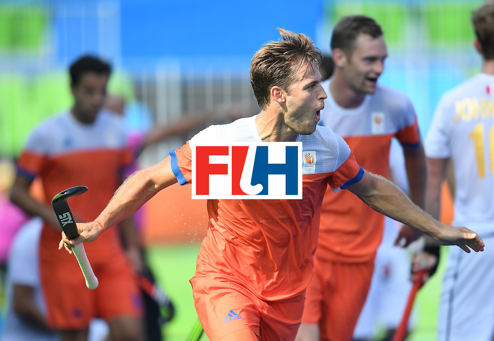 Netherland's Jeroen Hertzberger celebrates scoring a goal during the men's field hockey Netherlands vs Canada match of the Rio 2016 Olympics Games at the Olympic Hockey Centre in Rio de Janeiro on August, 9 2016. / AFP / MANAN VATSYAYANA        (Photo credit should read MANAN VATSYAYANA/AFP/Getty Images)
