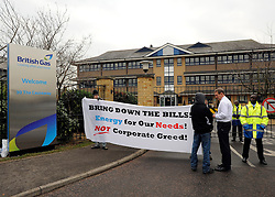 © Licensed to London News Pictures. 30/01/2012, Staines, UK. PHIL BENTLEY CEO (white shirt) of British Gas talks to protesters outside the building. 6 activists have barricaded themselves into meeting rooms on two floors of British Gas offices in Staines, Middlesex, as part of the 'Winter Warm-Up' weekend called by the campaign group Fuel Poverty Action. British Gas is being targeted as one of the Big Six energy companies making profits out of rising energy bills.   Photo credit : Stephen Simpson/LNP