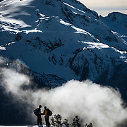 Kevin Sansalone and Ryan Paterson ponder the vastness of the abyss below Castle Towers Mountain. Whistler BC.