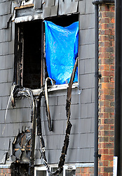 &copy; Licensed to London News Pictures. 08/08/2018<br /> Deptford, UK. Fire damage to a window at a property where 7 year Joel Urhie was killed in a suspicious house fire at Adolphus Street, Deptford.  <br /> Photo credit: Grant Falvey/LNP