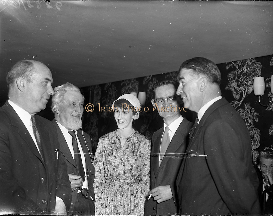 """27/05/1959<br /> 05/27/1959<br /> 27 May 1959<br /> Presentation of Esso Perpetual Trophy to the Listowel Drama Group at the Shelbourne Hotel, Dublin. The trophy and replicas for the  All Ireland Amateur Dram festival were presented by Mr. T.F. Laurie, Chairman and Managing Director of Esso Petroleum Co. (Ireland) Ltd. at a special luncheon. The Listowel group won the competition with their performance of the 3 Act play """"Sive"""" by John B. Keane. Shown chatting at the reception (l-r) are Mr Seamus Wilmot (Listowel) Registrar N.U.I.; Mr Maurice Walsh, novelist; Miss Siobhan Cahill, in cast of """"Sive""""; Mr Brendan Carroll, Producer and Mr Bryan McMahon, President Listowel Drama Group who received the trophy."""