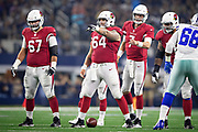ARLINGTON, TX - AUGUST 26:  Mason Cole #64 of the Arizona Cardinals at the line of scrimmage during a game against the Dallas Cowboys at AT&T Stadium during week 3 of the preseason on August 26, 2018 in Arlington, Texas.  The Cardinals defeated the Cowboys 27-3.  (Photo by Wesley Hitt/Getty Images) *** Local Caption *** Mason Cole