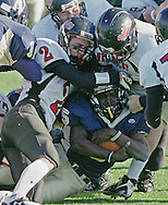 (Needham, MA - November 27, 2008) - Wellesley Raiders defenders tackle Needham Rockets running back Jean Baptiste in the first quarter. Baptiste finished the game with over 200 yards rushing and the Rockets took home the spoils, winning 26-7 in the 121st meeting between the the teams at Memorial Field. It is the oldest rivalry in high school football in the United States. ..Herald photo by Will Nunnally