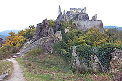 Wachau Valley, Austria: A line figure makes his way up and into the ruins of Durnstein castle.  Durnstein retains its historic character and air of romance, one of the most popular stops on the Danube on a cruise between Melk and Durnstein.  The Castle-ruin Durnstein still stands on the high bluff above town.