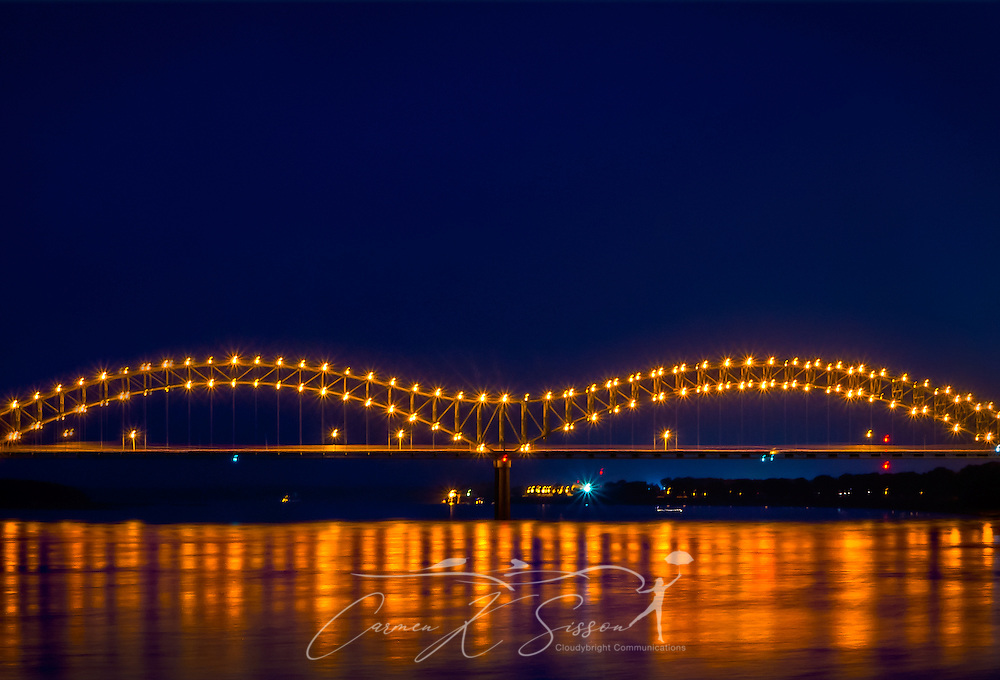 The Hernando de Soto Bridge, also called the M Bridge, is pictured at night, Sept. 5, 2015, in Memphis, Tennessee. The through arch bridge opened in 1973 and carries Interstate 40 traffice between Memphis, Tennessee and West Memphis, Arkansas. It features 200 sodium vapor lights outlining the M-shaped arches. The bridge was named for 16th century Spanish explorer Hernando de Soto, who explored this area of the Mississippi River and died south of Memphis. (Photo by Carmen K. Sisson/Cloudybright)