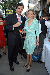 EDWARD TAYLOR and NATALIE HICKS-LOBBECKE at the launch of The Rupert Lund Showroom, 61 Chelsea Manor Street, London SW3 on 2nd May 2007.<br />