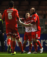 Scott Cuthbert of Leyton Orient (right) celebrates scoring the opening goal with Dean Cox of Leyton Orient (2nd right) during the Sky Bet League 1 match at the Matchroom Stadium, London<br /> Picture by David Horn/Focus Images Ltd +44 7545 970036<br /> 25/03/2014