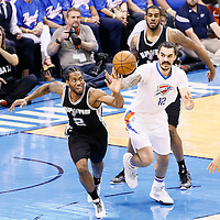 06 May 2016: San Antonio Spurs forward Kawhi Leonard (2) vies for the loose ball with Oklahoma City Thunder center Steven Adams (12) during the San Antonio Spurs 100-96 victory over the Oklahoma City Thunder, during Game Three of the Western Conference Semifinals of the NBA Playoffs at the Chesapeake Energy Arena, Oklahoma City, Oklahoma, USA.