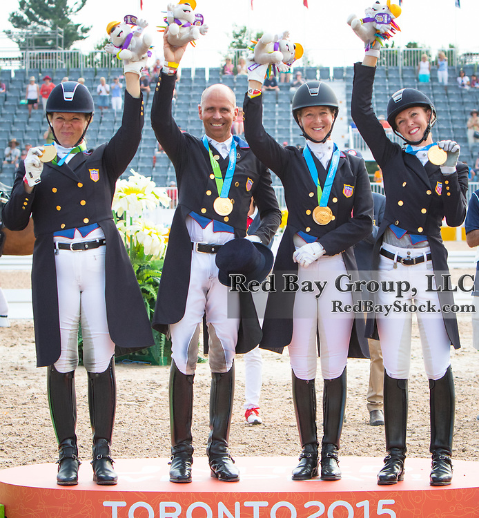 US Gold Medal Team, Kimberley Herslow, Steffen Peters, Sabine Schut-Kery and Laura Graves on the podium at the OLG Caledon Pan Am Equestrian Park during the Toronto 2015 Pan American Games in Caledon, Ontario, Canada.