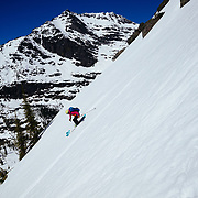 Sophie Danison skiing a ridgline in the backcountry of Glacier National Park.