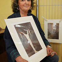 Gloria Pahad holding one of her pieces which is currently on display in Teach Ceoil in Ennistymon as part of the Ennistymon Vocational School FETAC students art exhibition.  Large piece 'Yerma' and small piece 'Fahy's Alley'.<br /> <br /> Photograph by Yvonne Vaughan.