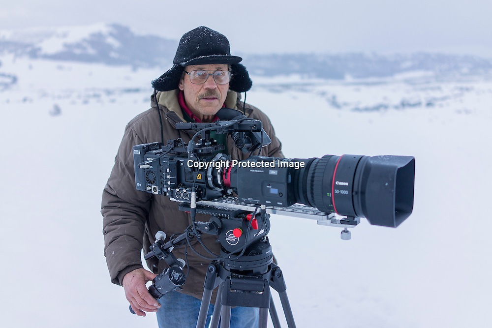 Natural history cinematographer Bob Landis with his Sony F-55, AXS-R5 Raw recorder, and Canon 50-1000 lens filming wolves in Yellowstone National Park.
