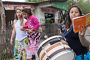 Amanda (right) and a group of children on their stilts, playing music, singing and reciting poetry in the community near the library, Biblioteca Comunitaria do Arquipelago, Porte Alegre, Brazil. <br /> <br /> Cirandar is working in partnership with  C&A and C&A Instituto to implement a network of Community Libraries in eight communities of Porto Alegre.