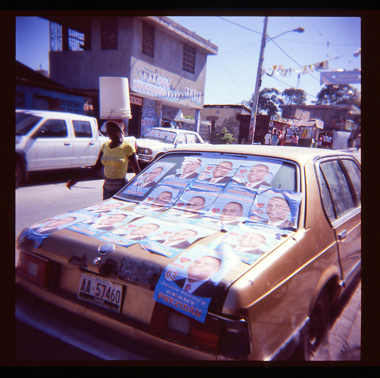 Posters for Haitian presidential candidate Jean Ceant are plastered on a car on Wednesday, November 24, 2010 in Port-au-Prince, Haiti.