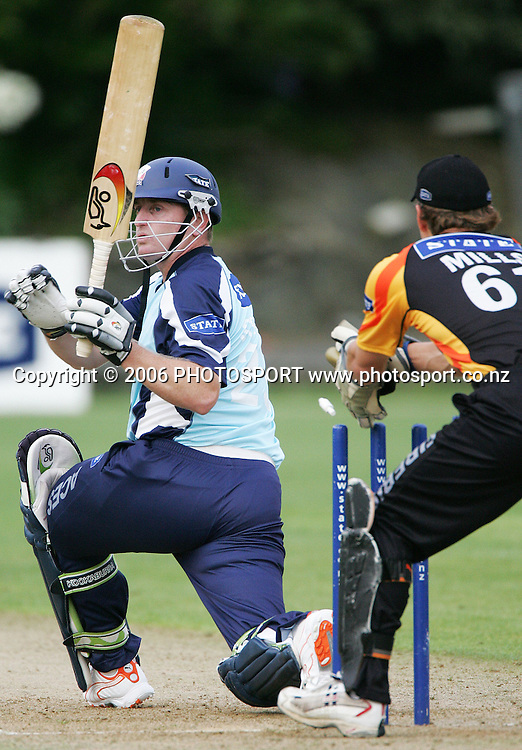 Firebirds wicketkeeper Stu Mills attempts to stump Aces batsman Scott Styris during the State Twenty20 cricket match between the Auckland Aces and Wellington Firebirds at Eden Park Outer Oval held in Auckland, New Zealand on Thursday 11 January 2007. Auckland won the match by 7 wickets. Photo: Tim Hales/PHOTOSPORT