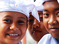 A group of young, smiling boys at the Puri Agung ceremony, Bali, Indonesia.