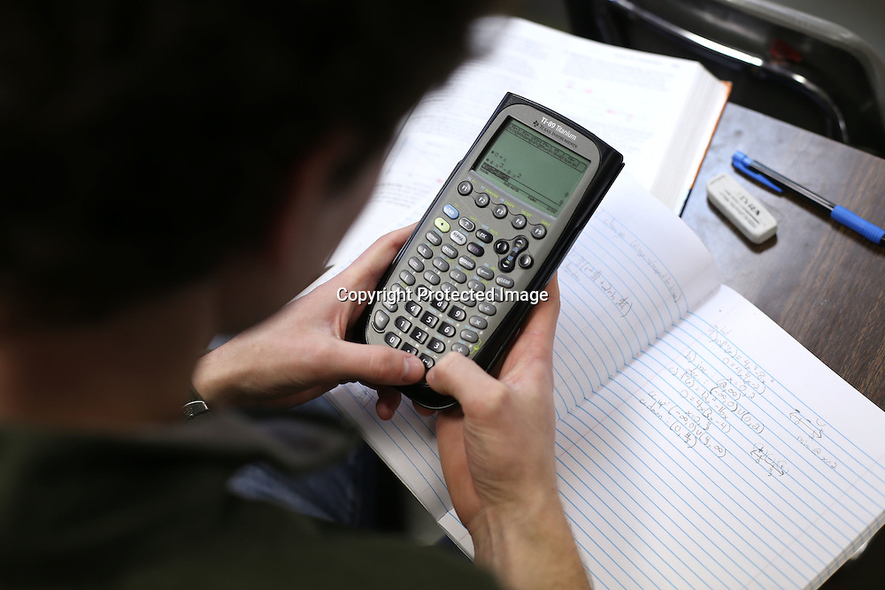 Adam Robison | BUY AT PHOTOS.DJOURNAL.COM<br /> Daniel Villaflor, a Senior at Corinth High School, works equations on his calculator in Vicki Shirley's AP Calculus class Friday morning. Corinth School District was one of two districts in the state with the highest graduation rate.