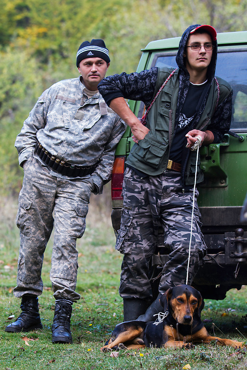 Young Romanian man helping as a driver during a driving hunt for Wild boar (Sus scrofa) and hunting  dog (breed: Copoi ardelenesc). Mehadia, Caras Severin, Romania.