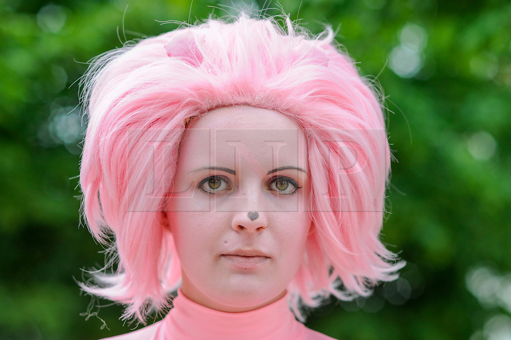 © Licensed to London News Pictures. 28/05/2017. London, UK. A girl dressed as Pink Lion from Steven Universe, a tv show, at MCM Comic Con taking place at Excel in East London.  The three day event celebrates popular comic books, anime, games, television and movies.  Many attendees take the opportunity to dress as their favourite characters.    Photo credit : Stephen Chung/LNP