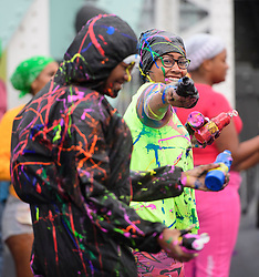 © Licensed to London News Pictures. 28/08/2016. London, UK. Revellers enjoy Jouvert, a paint fight that officially marks the start of the Notting Hill carnival. The two day event is the second largest street festival in the world after the Rio Carnival in Brazil, attracting over 1 million people to the streets of West London. Photo credit: Ben Cawthra/LNP