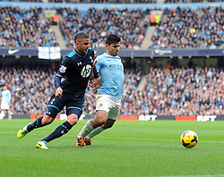 Manchester City's Sergio Aguero and Tottenham Hotspur's Kyle Walker race for the ball - Photo mandatory by-line: Dougie Allward/JMP - Tel: Mobile: 07966 386802 24/11/2013 - SPORT - Football - Manchester - Etihad Stadium - Manchester City v Tottenham Hotspur - Barclays Premier League