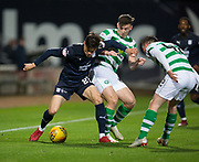 31st October 2018, Kilmac Stadium, Dundee, Scotland; Ladbrokes Premiership football, Dundee v Celtic; Jesse Curran of Dundee challenges for the ball with Kieran Tierney and Callum McGregor of Celtic