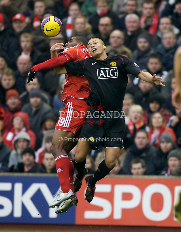 LIVERPOOL, ENGLAND - Sunday, December 16, 2007: Liverpool's Ryan Babel and Manchester United's Wes Brown during the Premiership match at Anfield. (Photo by David Rawcliffe/Propaganda)