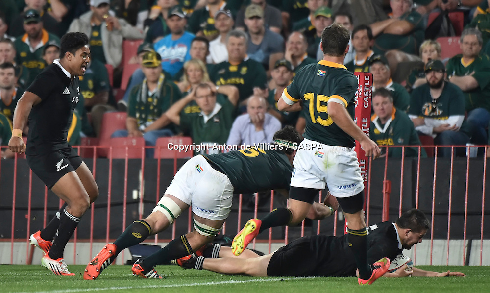 JOHANNESBURG, South Africa, 04 October 2014 : Dane Coles of the All Blacks goes over for his try during the Castle Lager Rugby Championship test match between SOUTH AFRICA and NEW ZEALAND at ELLIS PARK in Johannesburg, South Africa on 04 October 2014. <br /> The Springboks won 27-25 but the All Blacks successfully defended the 2014 Championship trophy.<br /> <br /> &copy; Anton de Villiers / SASPA