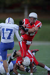 17 October 2009:  Bert Whigham pushes into the backfield to block a punt attempt by Gabe Mullane. The Indiana State Sycamores tumble to the Illinois State Redbirds 38-21 at Hancock Stadium on campus of Illinois State University in Normal Illinois