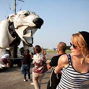The giant polar bear Aurora is test run on North Weald Airfield near Epping. It is the first day that puppeteers get a chance to get her legs and feet moving. Aurora, a double-decker-bus-size polar bear puppet specially commissioned by Greenpeace to lead an Arctic-inspired street parade to the London HQ of oil giant Shell on 15 September. The three-tonne marionette bear will be operated from the inside by a team of 15 puppeteers, including artists from West End blockbuster War Horse, and will be hauled on ropes by 30 volunteers along a route including the Houses of Parliament and Westminster Bridge.