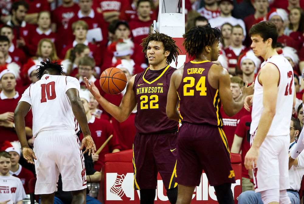 Center Reggie Lynch (22), center, contests a foul call during the first half of the University of Minnesota Men's Basketball game versus University of Wisconsin on March 5, 2017.