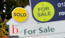File photo dated 14/10/14 of Sold and For Sale signs, as according to an index house prices reached a new record high of on average in April.