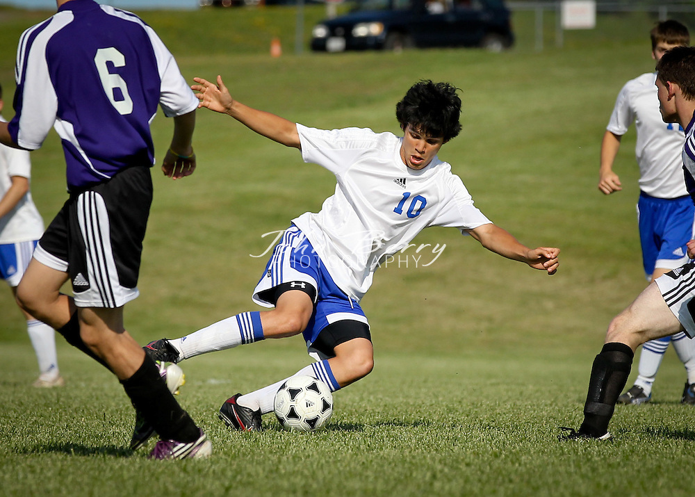 Matt Batman shows some fancy footwork during Madison's varsity soccer match with Strasburg.  Matt scored a goal and Nick Camillucci scored two to give Madison their first win of the season, defeating the Rams 3-0.  May/10/11:  MCHS Varsity Boys Soccer vs Strasburg.  Madison defeats Strasburg 3-0.