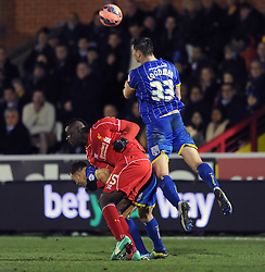 Liverpool's Mario Balotelli challenges for the header with Wimbledon's Jake Goodman - Photo mandatory by-line: Dougie Allward/JMP - Mobile: 07966 386802 - 05/01/2015 - SPORT - football - London - Cherry Red Records Stadium - AFC Wimbledon v Liverpool - FA Cup - Third Round