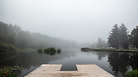 Canoe dock at a pond on a foggy morning at Jester Park, Iowa