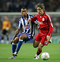 Photo: Paul Thomas.<br /> Porto v Liverpool. UEFA Champions League Group A. 18/09/2007.<br /> <br /> Fernando Torres (R) of Liverpool battles with Bosingwa.
