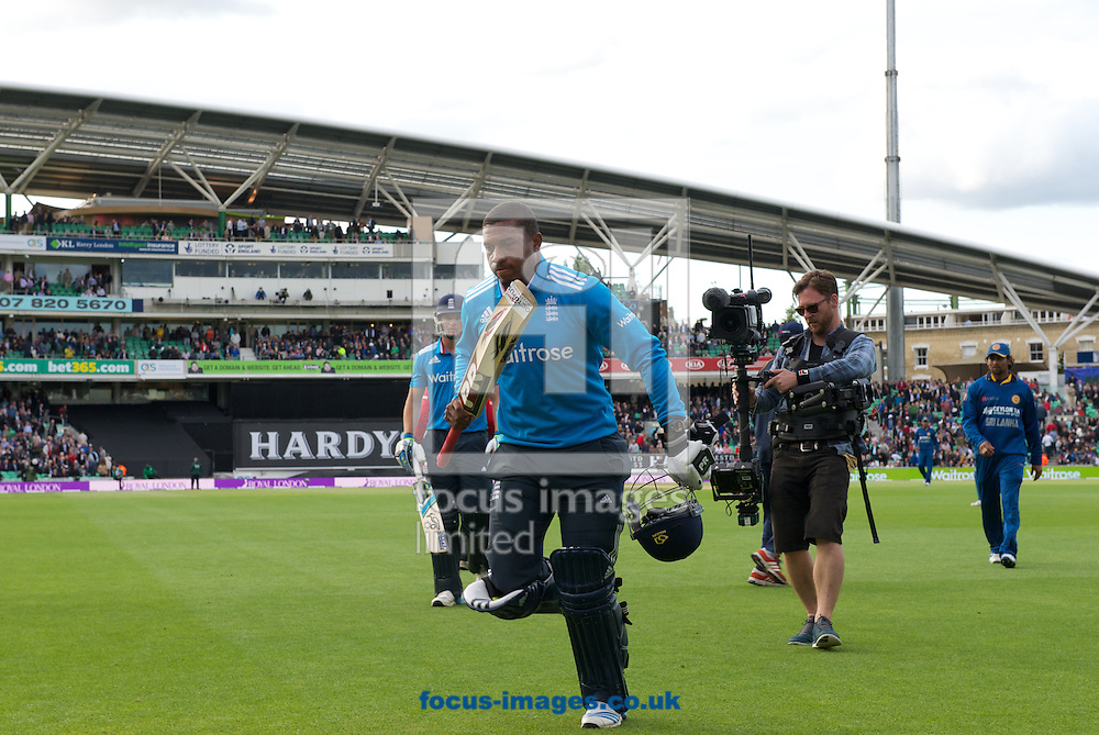 Chris Jordan of England leaves the pitch not out at the end of the 37 overs during the Royal London One Day Series match at the Kia Oval, London<br /> Picture by Alan Stanford/Focus Images Ltd +44 7915 056117<br /> 22/05/2014