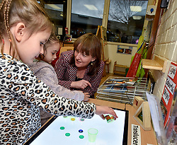 Pictured: Maree Todd meets Lucy Mason (4) and Kianna Armit (3)<br /> <br /> Minister for Children and young people Maree Todd launched the Scottish Government's new national standards for childcare and early years providers on a visit to the Treetop Family Centre in Inverkeithing.<br /> <br /> &copy; Dave Johnston / EEm