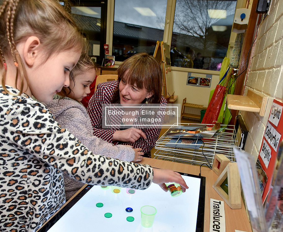 Pictured: Maree Todd meets Lucy Mason (4) and Kianna Armit (3)<br /> <br /> Minister for Children and young people Maree Todd launched the Scottish Government's new national standards for childcare and early years providers on a visit to the Treetop Family Centre in Inverkeithing.<br /> <br /> © Dave Johnston / EEm