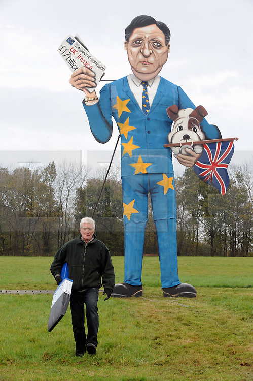 © Licensed to London News Pictures. 05/11/2014<br />  Jose Manuel Barroso the President of the EU unveiled as the Edenbridge Celebrity Guy. Artist with large paint brush is Frank Shepherd.<br /> Photo call for the unveiling of the Edenbridge Bonfire Society celebrity Guy. Edenbridge,Kent.<br /> (Byline:Grant Falvey/LNP)