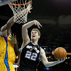 January 22, 2011; New Orleans, LA, USA; San Antonio Spurs forward Tiago Splitter (22) shoots over New Orleans Hornets center Emeka Okafor (50)during the fourth quarter at the New Orleans Arena. The Hornets defeated the Spurs 96-72.  Mandatory Credit: Derick E. Hingle
