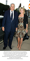 SIR EVELEYN & LADY DE ROTHSCHILD at a wedding in Suffolk in London on 20th September 2003.PMT 224
