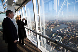 **PICTURES STRICTLY EMBARGOED INTIL 00:01 HOURS FRIDAY 11 JANUARY 2013** © London News Pictures. London, UK.  A group of people looking at the London Skyline during a media preview of the viewing level of The Shard building in London ahead of the public opening of 'A View From The Shard' on February 1, 2013. The public can view a 360 degree view of the capital from the 72nd floor of Western Europe's tallest building which stands at 800ft (244m).  Photo credit : Ben Cawthra/LNP